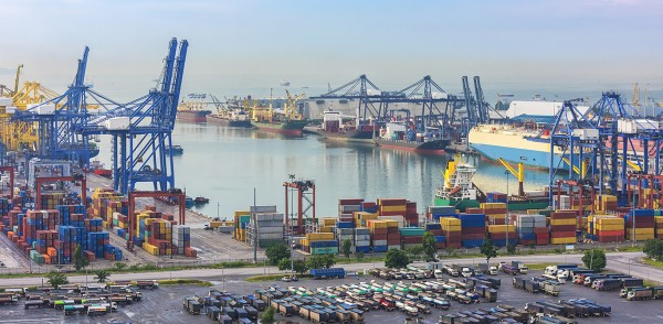 CILT Our role in logistics and transport view of a port with containers, ships and trucks