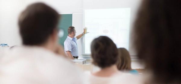CILT Training - Man training witha projector screen