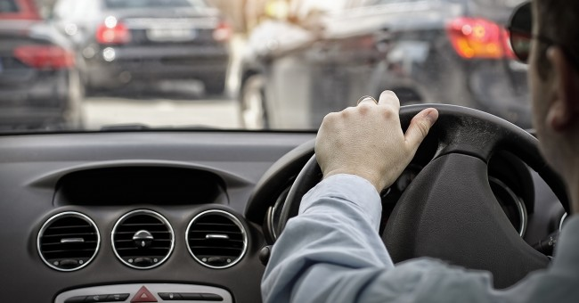 CILT UK Conferenve on urban logistics with a man driving a car in an urban ennvironment