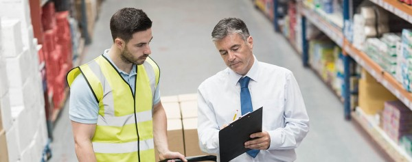 CILT Working together with two men talking in a warehouse