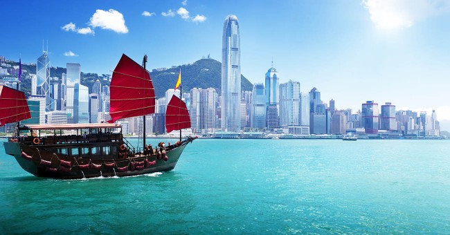 CILT Sutainable Transport in Hong Kong with the skyline and a boat