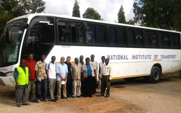 CILT and Trasnaid Driver Traing image with ITC Members and a bus