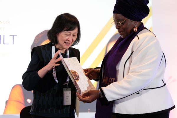Dorothy Chan presents a card of well wishes to Aisha Ali Ibrahim