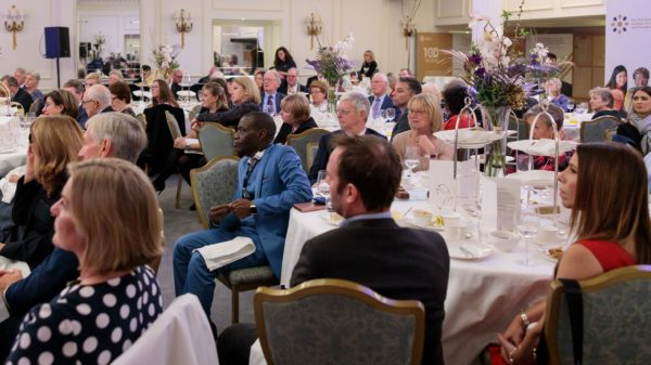 Guests listen to proceedings