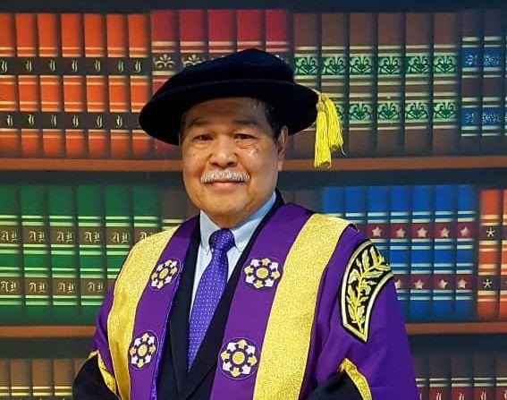 Portrait of Radzak Malek in academic robes