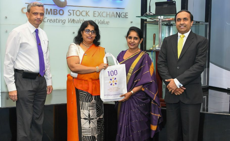 Gayani de Alwis giving gifts to members of the Colombo stock exchange during a visit